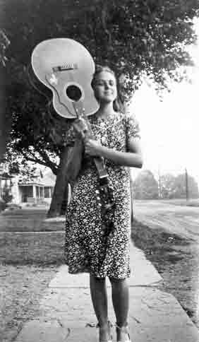 Ruby age 15 in 1939 carrying guitar on Pine Street