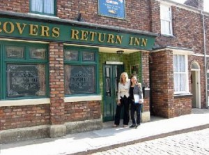Debbie Travis in front of Rovers in Corrie Crazy doc