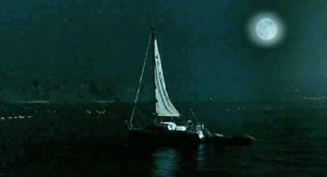 sailboat at night on lake