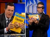 Stephen Colbert saved by Cheerios & evil twin Pavros holding products