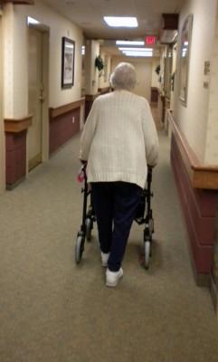 woman walking in hallway, alzheimer's
