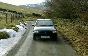 car on narrow road, before the crash