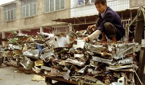 Man with electronic waste at recycling depot in China