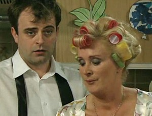 Liz, with curlers in hair, explains childhood to Steve