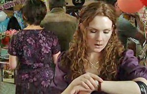 Fiz at party, checking her watch