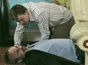John looking at Colin, dead - the farce begins