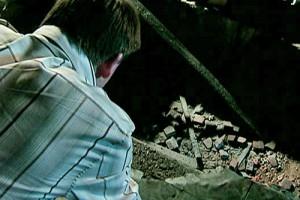 John looks at hole in factory floor
