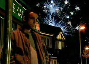 Kevin on Street with fireworks behind him