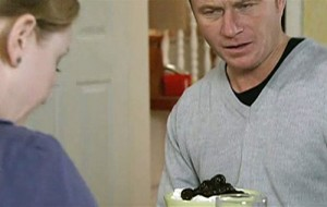 Ashley looking at his prunes and yoghurt breakfast