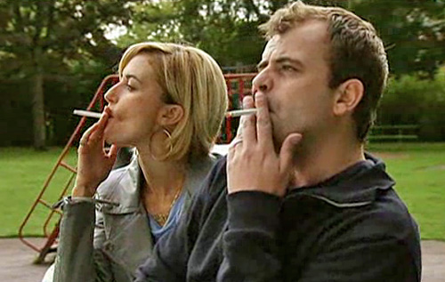 Becky and Steve smoking on park bench