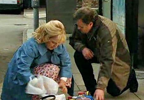 Brian helps Julie pick up spilled shopping bags