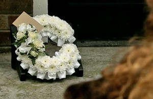 Fizz looking at wreath on factory steps