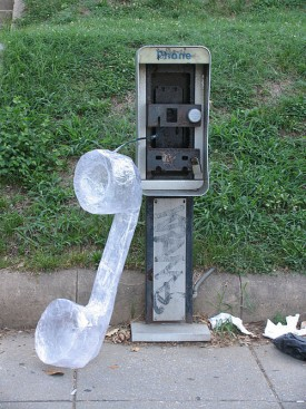 Telephone booth art installation by Mark Jenkins, photo wikicommons storker 2005