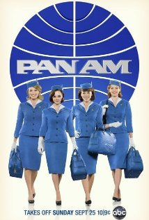 stewardesses in front of Pan Am logo ad poster