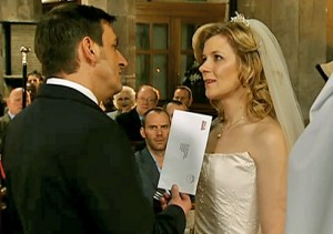 Peter showing Leanne lawyer's letter at altar