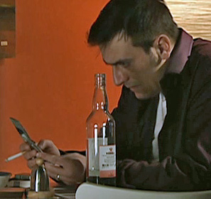 Peter drinking and phoning Nick for help