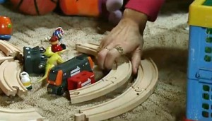 Becky packs up toy train set
