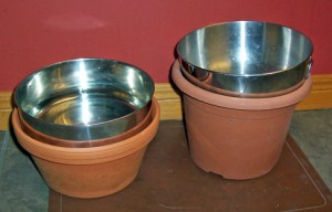 dog bowls raised with two sizes of flower pots photo D Stewart