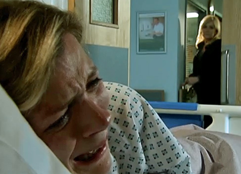 Leanne crying while Stella reappears at the hospital room door