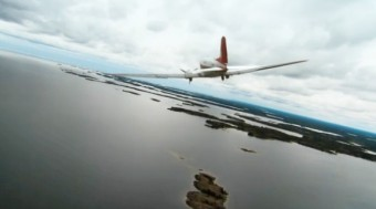 DC-3 flying over water