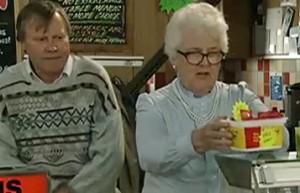 Sylvia putting priced sachets on counter