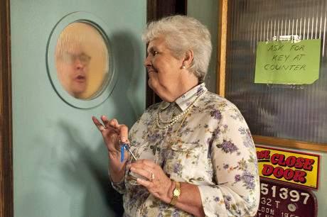 Norris looking through washroom window at Sylvia