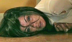 Carla lying on floor after rape
