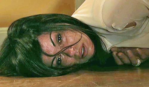 Carla lying on floor after rape