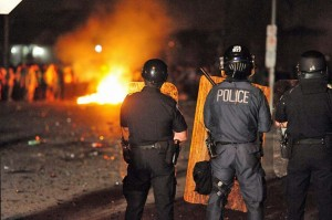 Police in riot gear watching fires near Fanshawe March 18 2012