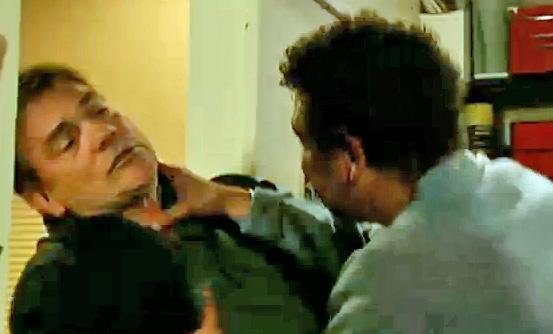 Lloyd grabs Karl in Streetcars office