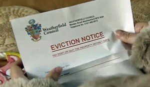 Katie reads eviction notice