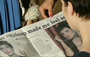 Rosie reading her story in the Gazette