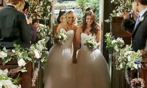 Brides walking toward altar