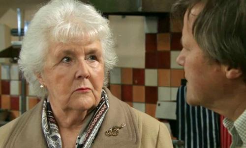 Sylvia looks at Roy