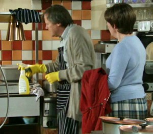 Roy scrubbing counter as Hayley remonstrates