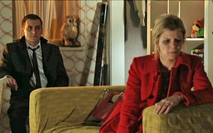 Leanne with back to Peter as he explains his affair