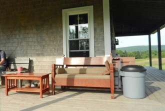 settee and table on house porch photo D Stewart