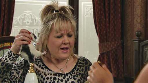 Beth holding up rat Darryl