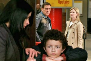 Leanne and Peter look at Simon with Carla