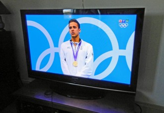 Olympic medal presentation on big screen