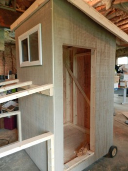 coop with plywood siding