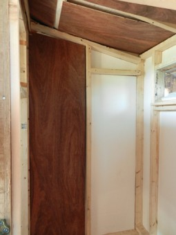 inside coop with wall insulation and panelboard