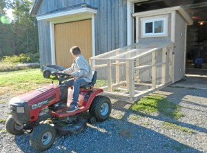 Coop being pulled with lawn tractor