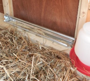 trough style feeder and plastic chick waterer