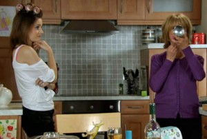 Kylie and Gail in kitchen discussing waitress job