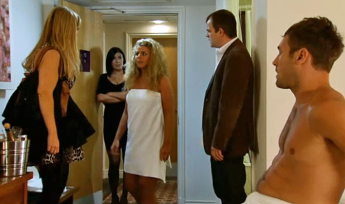 girl emerges from bathroom to room full of people