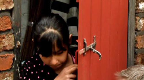 Asha-opening-door