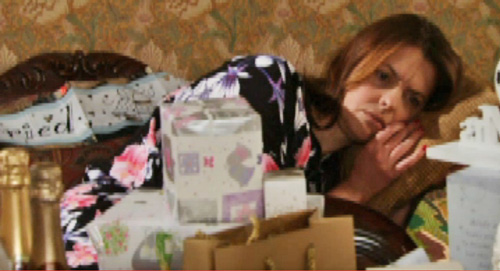 Poor tracy luv lies on couch, wedding presents in front