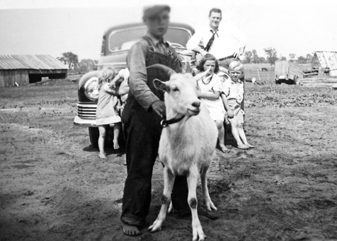 herc-burwell with goat, j k-sneade and burwell-kids back by car