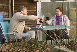 roy gives cathy a top up of tea